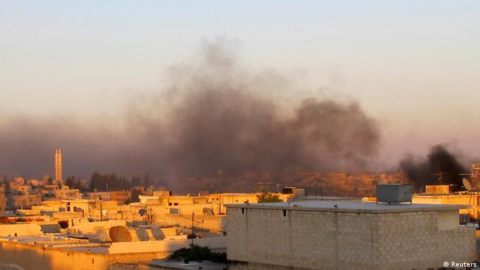 Source News Feed: EMEA Picture Service ,Germany Picture Service Smoke rises after government forces fire mortar in Azzaz, Aleppo province July 17, 2012. Picture taken July 17, 2012. REUTERS/Abdo (SYRIA - Tags: POLITICS CIVIL UNREST MILITARY )
