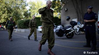 An Israeli military personnel arrive at a hospital in the city of Burgas, about 400km (248miles) east of Sofia July 19, 2012. A suicide bomber committed the attack that killed eight people in a bus transporting Israeli tourists at a Bulgarian airport, the country's interior minister said on Thursday, and Israel accused Iranian-backed Hezbollah militants of responsibility. REUTERS/Stoyan Nenov (BULGARIA - Tags: CRIME LAW TRANSPORT)