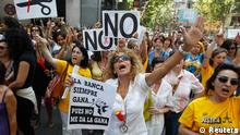 Justice civil servants shout slogans during a protest against government austerity measures in front of the headquarters of Spain's centre-right People's Party (Partido Popular) in Madrid July 19, 2012. Banner reads Banks always win? Well, I don't stand for it. REUTERS/Andrea Comas (SPAIN - Tags: CIVIL UNREST POLITICS BUSINESS EMPLOYMENT)