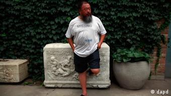Dissident artist Ai Weiwei waits for his lawyer to return after a verdict was announced in his lawsuit against the Beijing tax authorities in Beijing Friday, July 20, 2012. A Beijing court on Friday rejected an appeal by artist Ai against a more than $2 million fine for tax evasion, which he says is part of an intimidation campaign to stop him from criticizing the government. (AP Photo/Ng Han Guan)