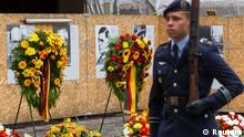 An honour guard takes up position during a ceremony at the site where a group of officers were shot after their failed attempt on the life of Adolf Hitler in the 'Bendlerblock' building in Berlin July 20, 2012. Germany on Friday remembered a group of military officers led by Claus von Stauffenberg who conspired to assassinate Hitler and overthrow the Nazi regime. Pictured in the background are portraits of the officers who took part in the plot. REUTERS/Thomas Peter (GERMANY - Tags: POLITICS ANNIVERSARY)