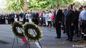 Norway's King Harald (R) and Prime Minister Jens Stoltenberg attend a wreath laying ceremony during a ceremony to mark the one year anniversary of the twin Oslo-Utoeya massacre by self confessed killer Anders Breivik, near the heavily damaged government building in Oslo July 22, 2012. REUTERS/Berit Roald/NTB Scanpix/Pool (NORWAY - Tags: POLITICS ROYALS ANNIVERSARY CIVIL UNREST)