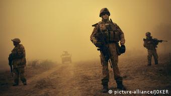 German Bundeswehr soldiers attached to ISAF on patrol near Kundus in northern Afghanistan