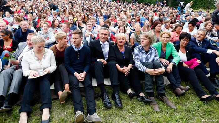 Members of AUF (The Labour Youth Organisation) sit with guests and relatives of those who died a year ago, on Utoeya island July 22, 2012, during the one year anniversary of the twin Oslo-Utoeya massacre by self confessed killer Anders Behring Breivik.(Photo: REUTERS/Heiko Junge/NTB Scanpix)