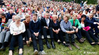 Members of AUF (The Labour Youth Organisation) sit with guests and relatives of those who died a year ago, on Utoeya island July 22, 2012, during the one year anniversary of the twin Oslo-Utoeya massacre by self confessed killer Anders Behring Breivik. Breivik, who said his mostly teenage victims were traitors because they supported multiculturalism and Muslim immigration, detonated a bomb outside parliament that killed eight, then shot dead 69 at the ruling Labour Party's youth camp on Utoeya. AUF Chairman Eskil Pedersen (2nd L), Norway's Prime Minister Jens Stoltenberg (3rd L), Norway's former Prime Minister Gro Harlem Brundtland (5th R), Denmark's Prime Minister Helle Thorning-Schmidt (3rd R) , Swedish social democratic politician Mona Sahlin (2nd R) and Norway's Foreign Minister Jonas Gahr Stoere (R) sit in the front row. REUTERS/Heiko Junge/NTB Scanpix (NORWAY - Tags: POLITICS CIVIL UNREST ANNIVERSARY TPX IMAGES OF THE DAY) THIS IMAGE HAS BEEN SUPPLIED BY A THIRD PARTY. IT IS DISTRIBUTED, EXACTLY AS RECEIVED BY REUTERS, AS A SERVICE TO CLIENTS. NORWAY OUT. NO COMMERCIAL OR EDITORIAL SALES IN NORWAY. NO COMMERCIAL SALES