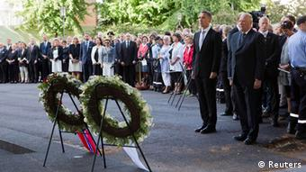 Norway's King Harald (R) and Prime Minister Jens Stoltenberg attend a wreath laying ceremony during a ceremony to mark the one year anniversary of the twin Oslo-Utoeya massacre by self confessed killer Anders Breivik, near the heavily damaged government building in Oslo July 22, 2012. REUTERS/Berit Roald/NTB Scanpix/Pool (NORWAY - Tags: POLITICS ROYALS ANNIVERSARY CIVIL UNREST TPX IMAGES OF THE DAY)