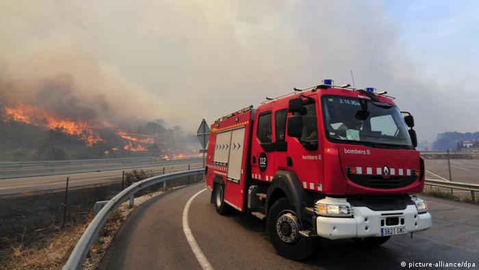 A fire brigade truck on the road near La Jonquera, Catalonia, Spain, where the fire broke out.
