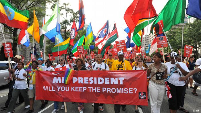 COMMERCIAL IMAGE - In this photograph taken by AP Images for AIDS Healthcare Foundation, marchers carry a banner during the Keep the Promise March on Washington and rally, Sunday, July 22, 2012, in Washington. (Larry French/AP Images for AIDS Healthcare Foundation)