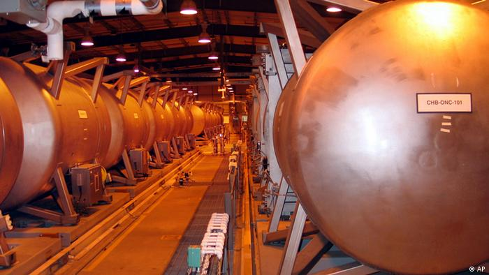 FILE - This June 8, 2004, file photo shows giant containment cylinders that will be used to move deadly chemical weapons from storage igloos to an incinerator inside the Umatilla Chemical Weapons Disposal Facility outside Hermiston, Ore. Nearly seventy years after the U.S. Government began storing chemical weapons at the site, workers started incinerating the final ton of mustard gas there Monday and Tuesday, destroying the last of the chemical weapons stockpile in the Northwest. (AP Photo/Jeff Barnard, file)
