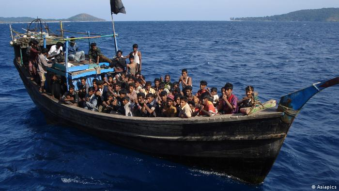 A powerless or engineless boat loaded with Rohingya refugees, moments before it was rescued by Indian Coastguards off Andaman Islands. Thai authorities forced the boatpeople board this boat which was then towed out to the middle of the sea and left to drift with very little food and water. Copyright: Asiapics 2010, near Andaman & Nicobar Islands, India