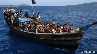 A powerless or engineless boat loaded with Rohingya refugees, moments before it was rescued by Indian Coastguards off Andaman Islands (Copyright: Asiapics 2010, near Andaman & Nicobar Islands, India)