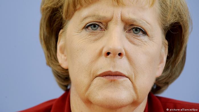 Merkel guckt skeptisch Foto: picture-alliance/dpa