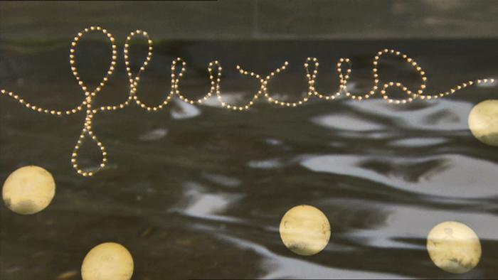 Symbolic photo with the word 'fluxus' in cursive with little moons around it
