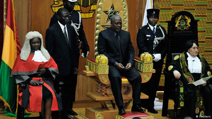 Ghana's Vice-President John Dramani Mahama (C) sits after taking the oath of office as head of state, hours after the announcement of the death of Ghana's President John Atta Mills, in the capital Accra, July 24, 2012. Mills, who won international praise for presiding over a stable model democracy in Africa, died suddenly on Tuesday and his vice-president was quickly sworn in to replace him at the helm of the oil, gold and cocoa producer. Mahama, 53, will serve as caretaker president until the elections at the end of the year. REUTERS/Yaw Bibini (GHANA - Tags: POLITICS ELECTIONS TPX IMAGES OF THE DAY)