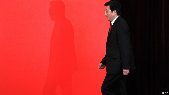 Newly-elected Beijing Municipal Communist Party Secretary Guo Jinlong steps onto a stage for photos during a press conference to introduce the city's top Communist Party leaders in Beijing Tuesday, July 3, 2012. (AP Photo/Alexander F. Yuan)