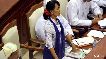 Myanmar's Opposition leader Aung San Suu Kyi asks a question during a regular session of the parliament