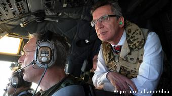 German Defense Minister Thomas de Maiziere sitting in a Transall C-160, flying from Kabul to Afghanistan on a visit earlier in the year.