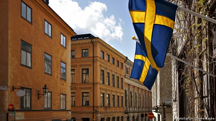 Swedish flags hang above a street in Stockholm