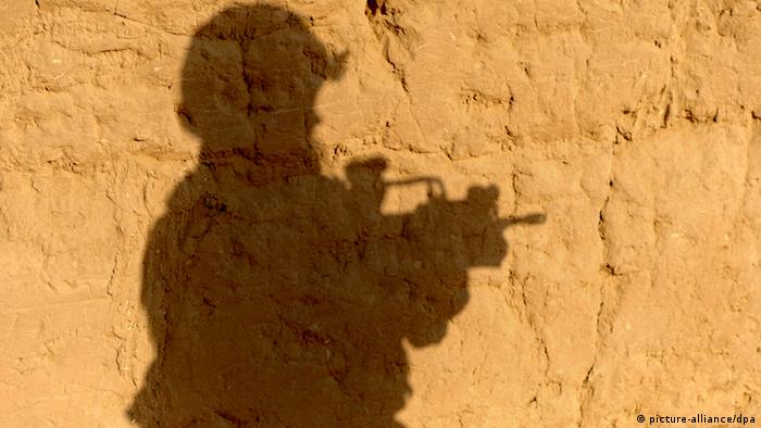The shadow of a soldier cast against a wall in Kunduz, Afghanistan. (Photo: Maurizio Gambarini dpa)