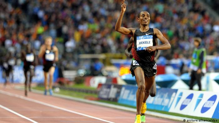 Ethiopia's Kenenisa Bekele celebrates while crossing the finish line to win the men's 10,000m race at the Memorial Ivo Van Damme - Diamond League athletics meeting in Brussels, Belgium, 16 September 2011.
