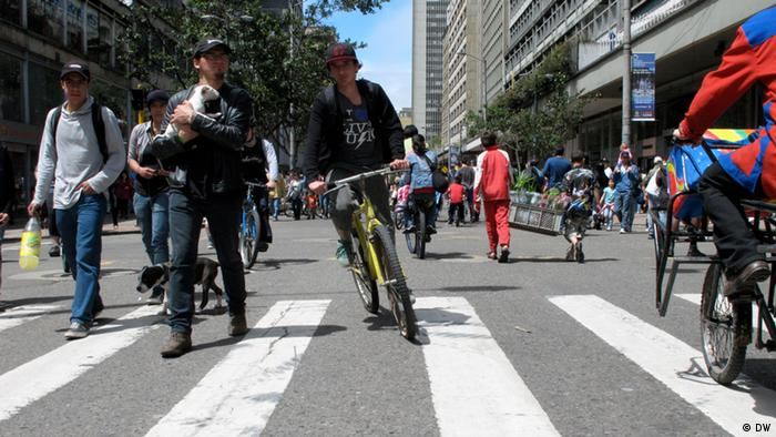 People walking and cycling on the street in Bogota