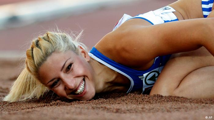 Greece's Voula Papachristou lands in the sand after her jump at the Women's Triple Jump final at the European Athletics Championships in Helsinki, Finland