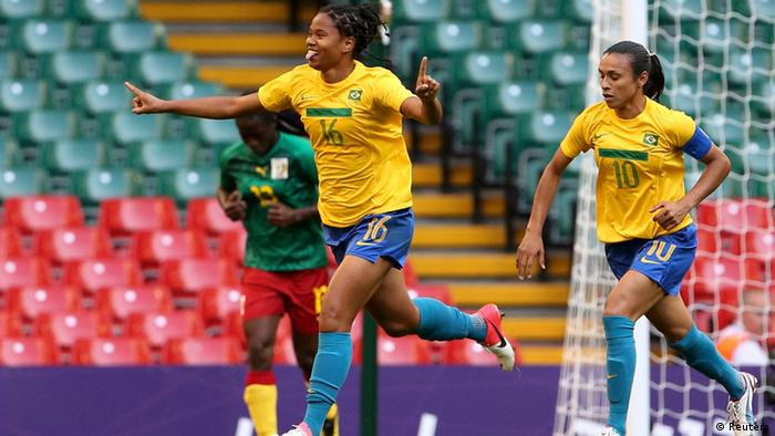 Brazil's Renata celebrates near her team mate Brazil's Marta after scoring a goal against Cameroon during their women's Group E football match at the London 2012 Olympic Games in the Millennium Stadium in Cardiff July 25, 2012. REUTERS/Francois Lenoir (BRITAIN - Tags: SPORT SOCCER SPORT OLYMPICS)