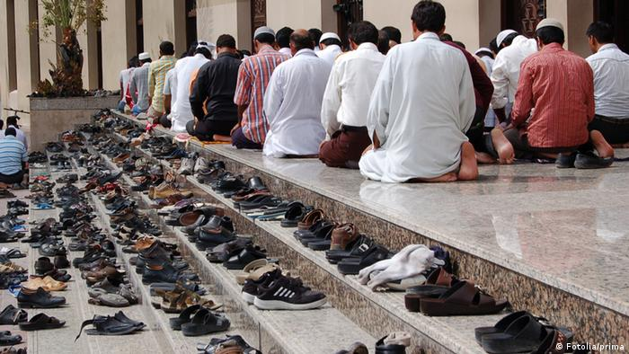 Shoes on a prayer mat Copyright: Fotolia/prima