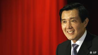 Taiwan's president-elect Ma Ying-jeou of opposition Nationalist Party smiles during a press conference a day after the presidential election in Taipei, Taiwan Sunday, March 23, 2008. Ma said Sunday he had no immediate plans to visit China and would work to fulfill his campaign pledge to improve relations with the communist neighbor, starting direct flights, allowing more Chinese tourists to visit and helping the island's financial industry go to the mainland. (AP Photo/Vincent Yu)