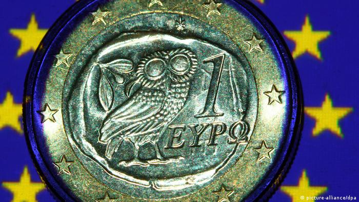 A Greek euro coin on a European flag Photo: Jens Büttner dpa/lmv