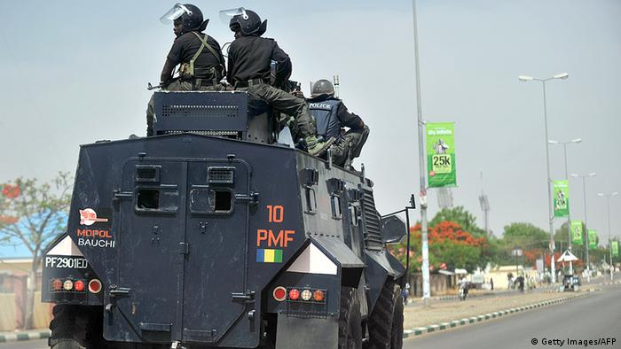 Nigerian police enforcing a curfew (Photo: TONY KARUMBA/AFP/Getty Images)