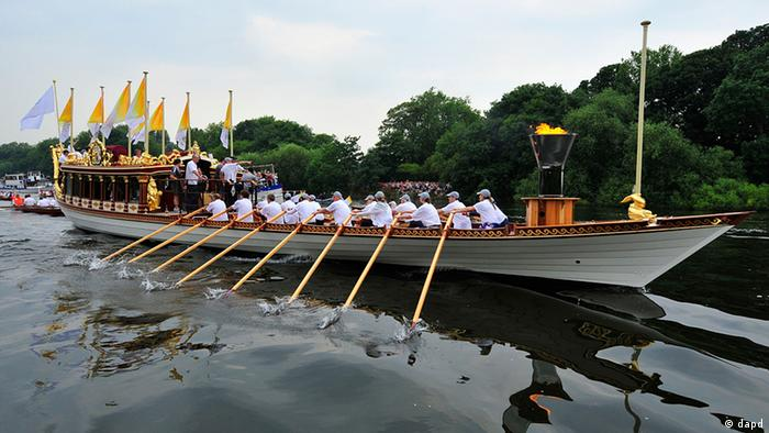 The royal barge Gloriana carrying Olympic flame on the last part of its journey