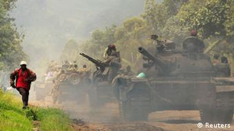 Congolese M23 rebels and government forces trade heavy weapons fire in eastern DRC. REUTERS/James Akena