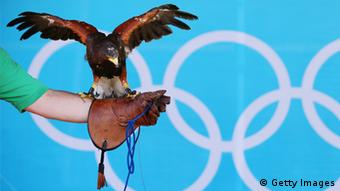 LONDON, ENGLAND - JULY 26: Hera the Harris's Hawk with handler Andrew Watson ahead of the London 2012 Olympics at the Olympic Park on July 26, 2012 in London, England. (Photo by Jeff J Mitchell/Getty Images)