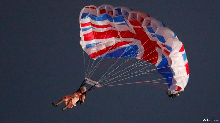 A performer playing the role of Britain's Queen Elizabeth parachutes from a helicopter during the opening ceremony of the London 2012 Olympic Games at the Olympic Stadium July 27, 2012, Copyright: REUTERS/Fabrizio Bensch