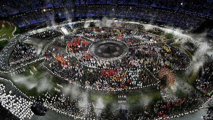 Athletes march in a parade during the Opening Ceremony at the 2012 Summer Olympics, Friday, July 27, 2012, in London.(AP Photo/Morry Gash)
