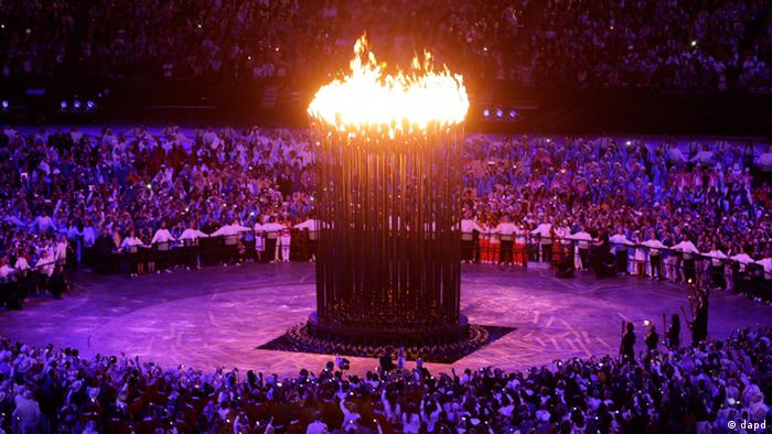 The Olympic cauldron is lit during the Opening Ceremony at the 2012 Summer Olympics, Saturday, July 28, 2012, in London. (AP Photo/Mark Baker)
