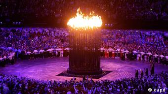 The Olympic cauldron is lit during the Opening Ceremony at the 2012 Summer Olympics