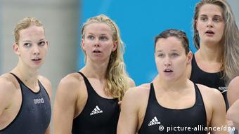 Daniela Schreiber, (L-R) Britta Steffen, Silke Lippok and Lisa Vitting of Germany react after the Women's 4x100m Freestyle Relay Heat during the Swimming competition held at the Aquatics Center during the London 2012 Olympic Games in London, England, 28 July 2012. The German Relay did not qualify for the finals. Photo: Michael Kappeler dpa
