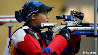 Malaysia's Nur Suryani Mohd Taibi takes aim during the women's 10m air rifle qualification competition at the London 2012 Olympic Games in the Royal Artillery Barracks at Woolwich in southeast London July 28, 2012. REUTERS/Kai Pfaffenbach (BRITAIN - Tags: SPORT OLYMPICS SPORT SHOOTING)