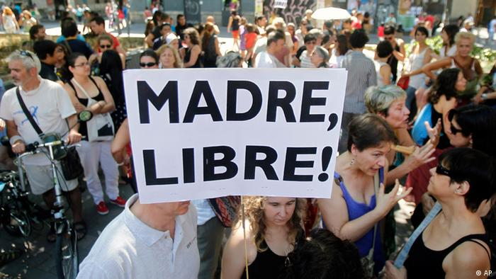 A protester with a banner reading Free Mother during a protest against abortion law reform in Madrid