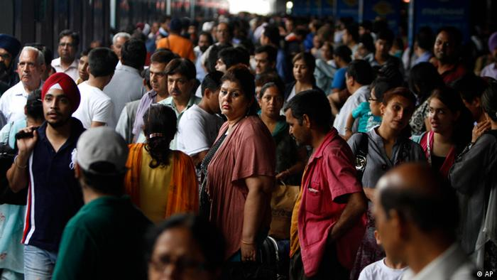 Stranded passengers wait for power to get restored at New Delhi railway station in New Delhi, India, Monday, July 30, 2012 (AP)