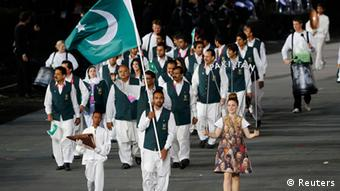 Pakistan's flag bearer Sohail Abbas (C) holds the national flag as he leads the contingent in the athletes parade during the opening ceremony of the London 2012 Olympic Games at the Olympic Stadium July 27, 2012 (Photo: REUTERS/Mike Blake)
