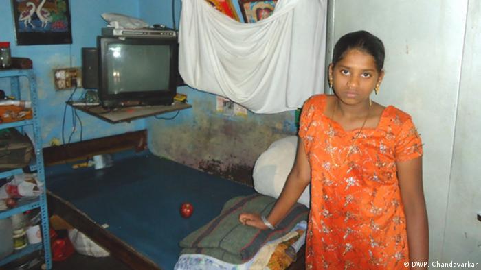 Kousalya stands inside one-room tenement