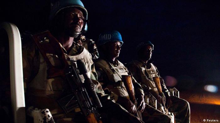 UNAMID peacekeepers from Ethiopia prepare to go on a night patrol on a pick-up vehicle, in Gereida (South Darfur), July 25, 2012.