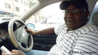 Driver Edward Sekyewa in his car