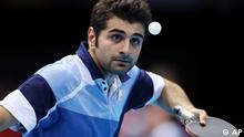Noshad Alamiyan of Iran competes against Tang Peng of Hong Kong during the men's singles table tennis at the 2012 Summer Olympics, Sunday, July 29, 2012, in London. (Foto:Sergei Grits/AP/dapd)