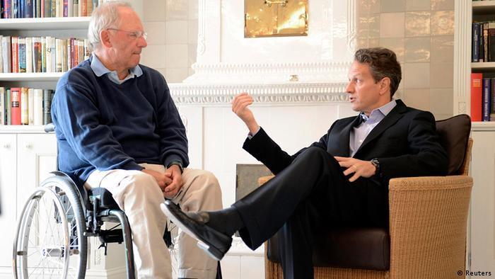German Finance Minister Wolfgang Schaeuble (L) talks to his U.S. counterpart Timothy Geithner in Westerland on the German island of Sylt, July 30, 2012. REUTERS/Fabian Bimmer (GERMANY - Tags: POLITICS BUSINESS)