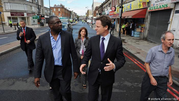 David Lammy (l) and Deputy Prime Minister Nick Clegg meet local residents and business people after rioting broke out in Tottenham, north London, Britain, 08 August 2011.