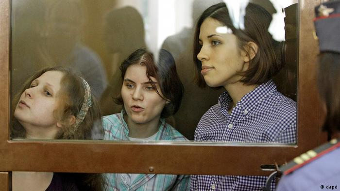 From left, Yekaterina Samutsevich, Maria Alekhina, Nadezhda Tolokonnikova, members of feminist punk group Pussy Riot sit behind bars at a court room in Moscow, Russia, Russia, Monday, July 30, 2012.Three members of the band are facing trial for performing a punk prayer against Vladimir Putin from a pulpit of Moscow's main cathedral before Russia's presidential election in March, in which he won a third term.
